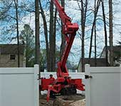 After entering this yard through the gate, you see the spiderlift in action for taking down a tree