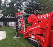 Our turf friendly spiderlift sqeezing through tight space to maneuver into position for tree removal